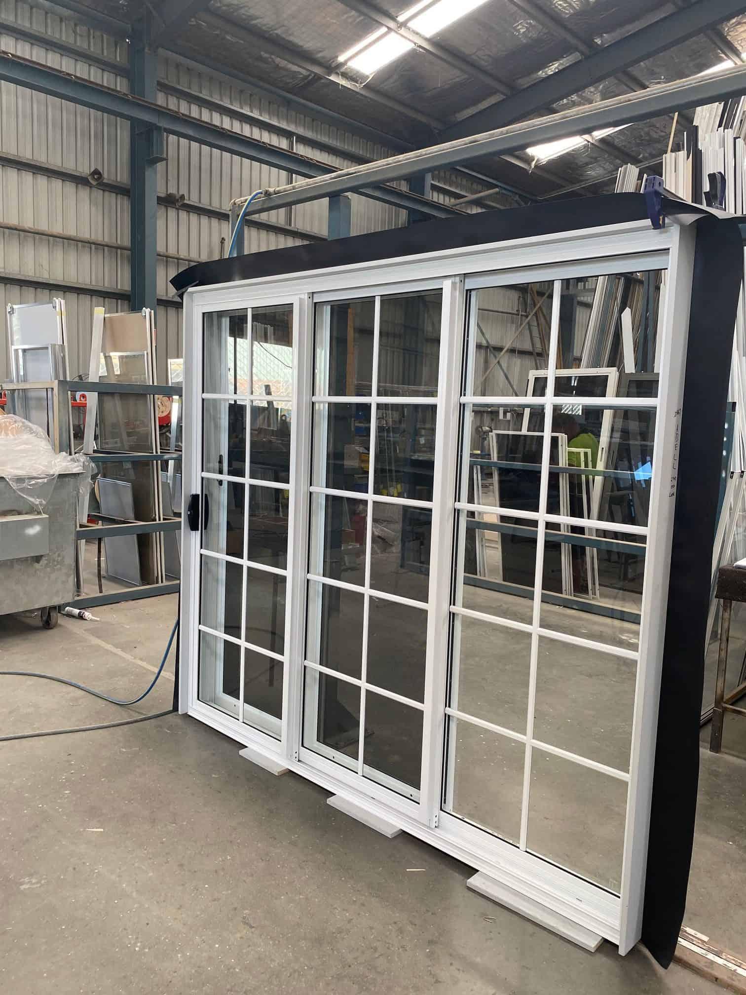 A white 3 panels stacker door created by Versalite Windows
