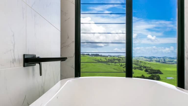 outdoor view through breezway louvres from bath tub