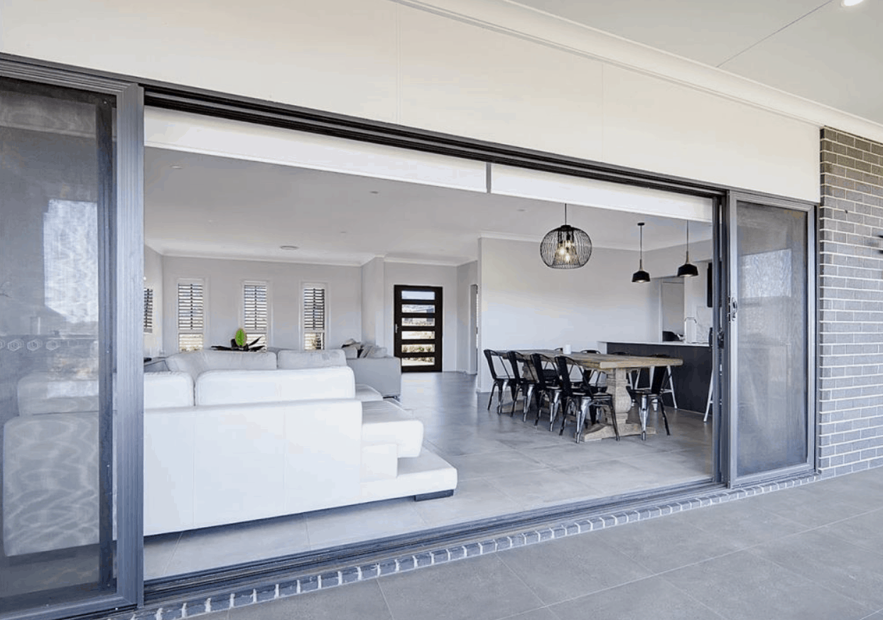 Sliding glass door with screen at the back of the house