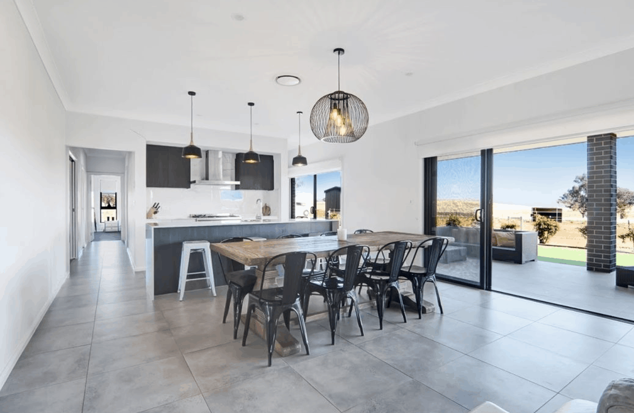 Dining and kitchen area has stacker doors