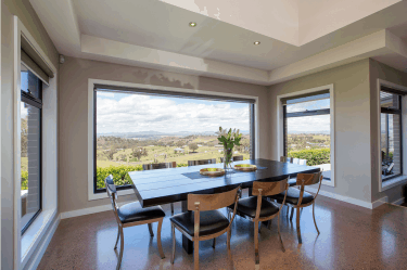 In a dining room with awning windows all over