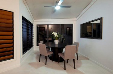 dining area with louvre windows that matches the colour of the house