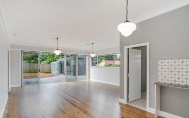 An empty house that has a sliding glass door and window