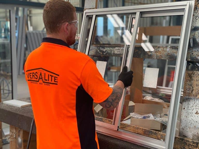 Versalite Windows team member preparing the sliding glass window he created