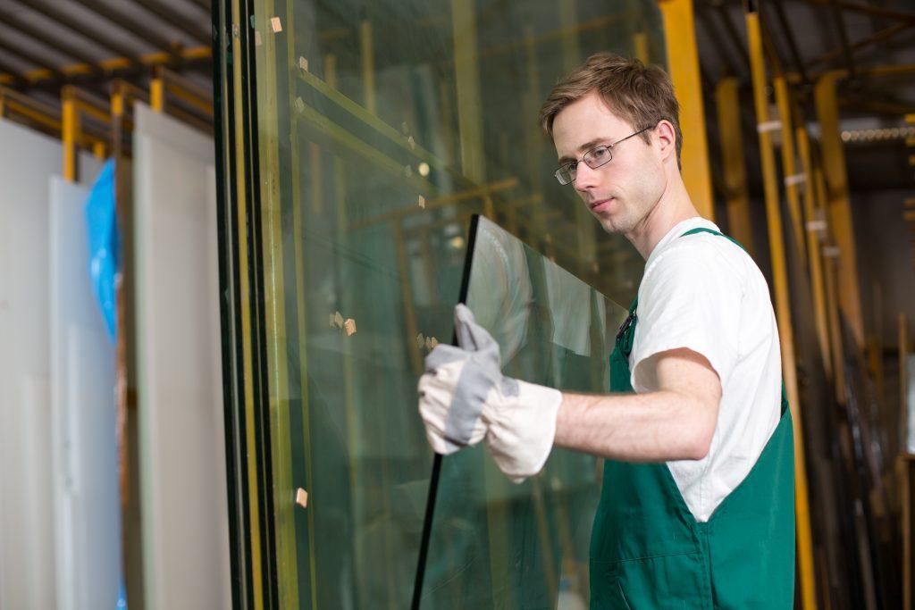 Worker,In,Glazier's,Workshop,,Warehouse,Or,Storage,Handling,Glass